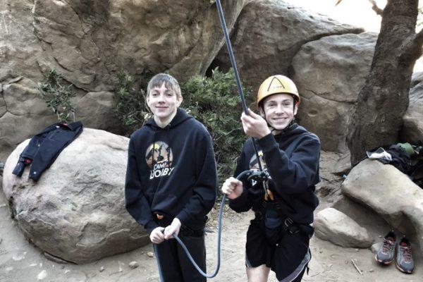 teen climbing outdoors
