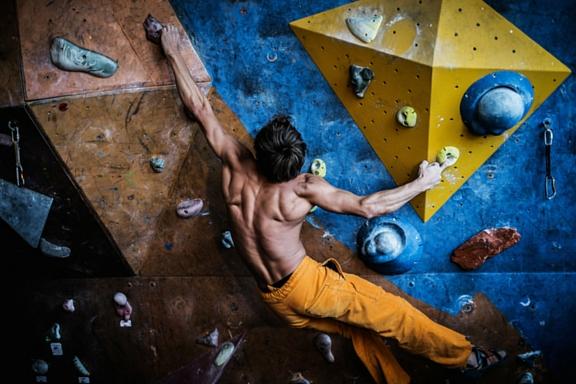 Climber-climbing-gym-strong